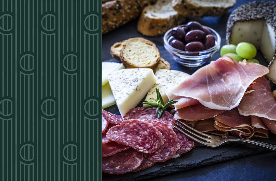 split image with vertical green rectangle overlaid with white vertical lines and the letter C repeated on the left and photo of antipasto plate on the right