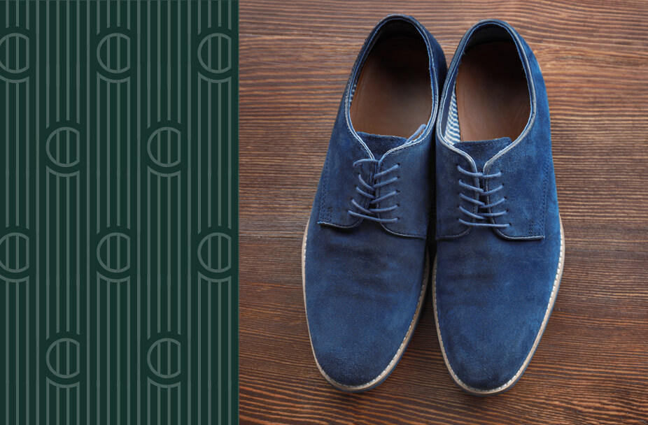split image with vertical green rectangle overlaid with white vertical lines and the letter C repeated on the left and color photo of blue suede shows on a wood grain floor on the right