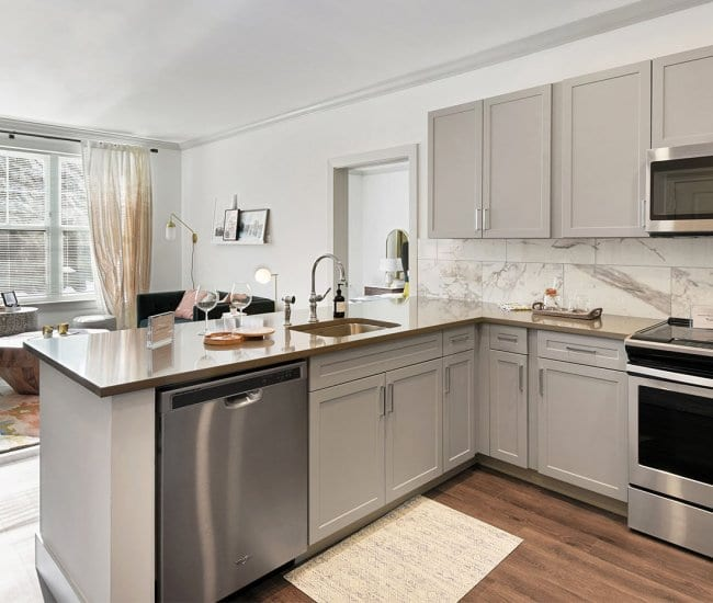 Kitchen and living room at Carraway apartments in Harrison, New York