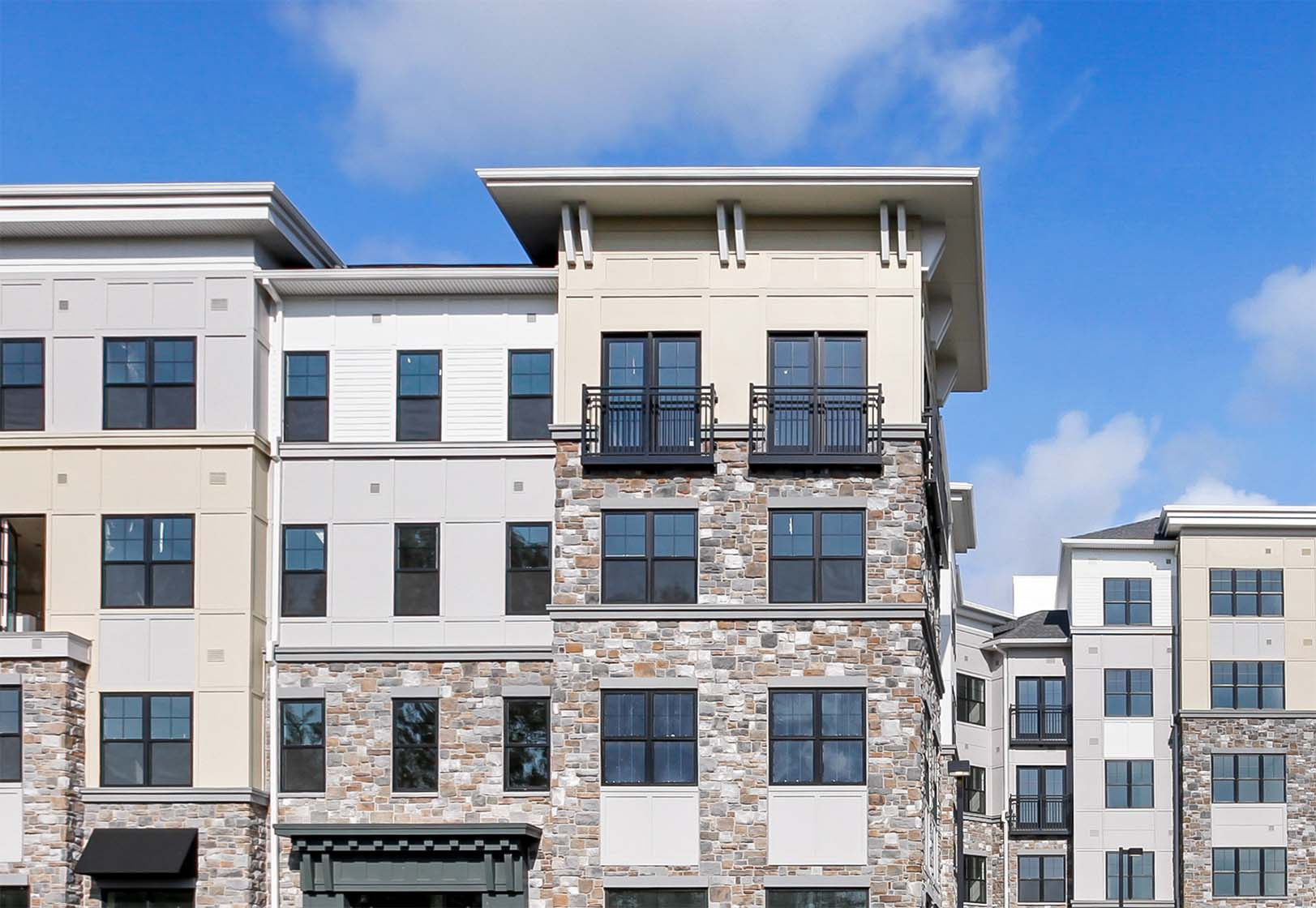 An exterior of Carraway feature Juliet balconies in select units.