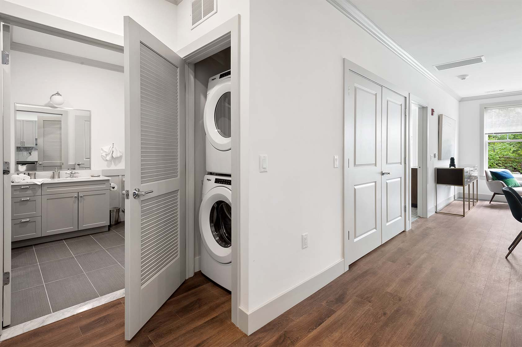 Large closet containing front-loading, stackable washer and dryer.